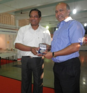 Provincial hands over medal to Tej director