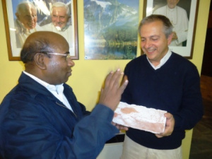 Cagliero Institute Director Fr. Eligio Caprioglio hands over to Fr Kanaga a brick from the missionary chapel. (file photo).