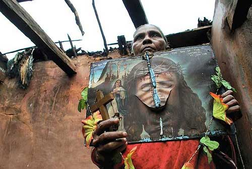 Kandhamal woman holding on to the symbols of her faith