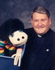 Fr Chris with Linus D. Lizard